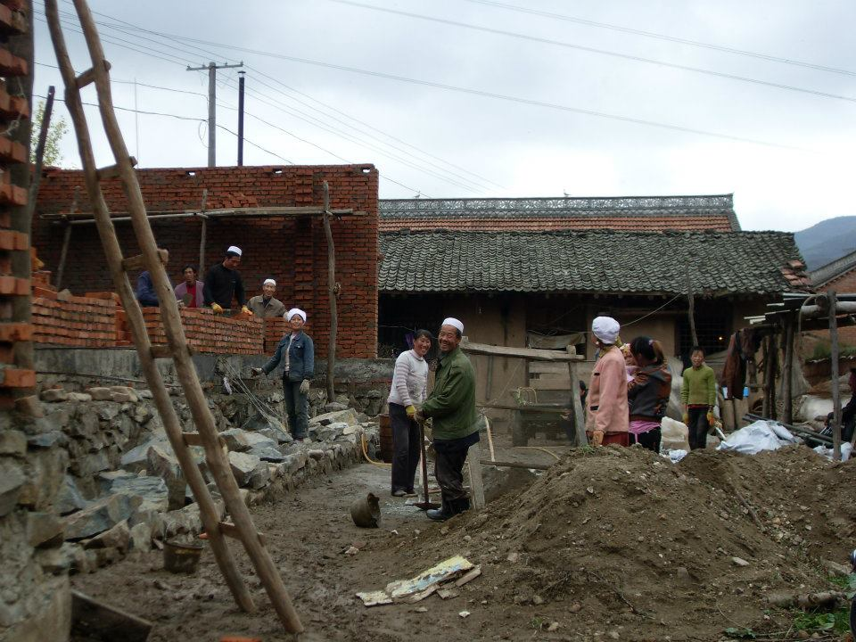 Some villagers working on the construction site of a recreational building.