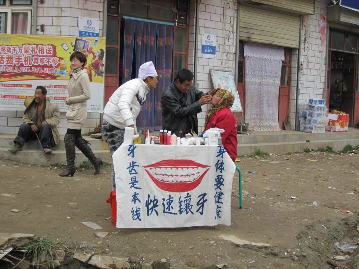 A pop-up dental service kiosk in the weekly market.