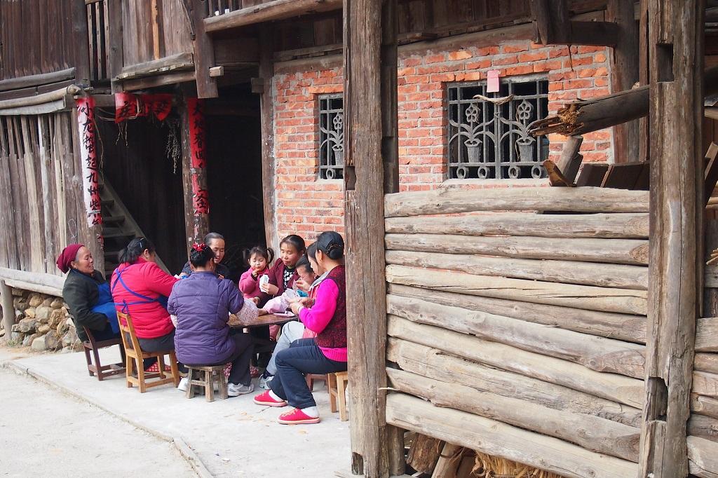 Village women enjoy playing card games during their leisure time.