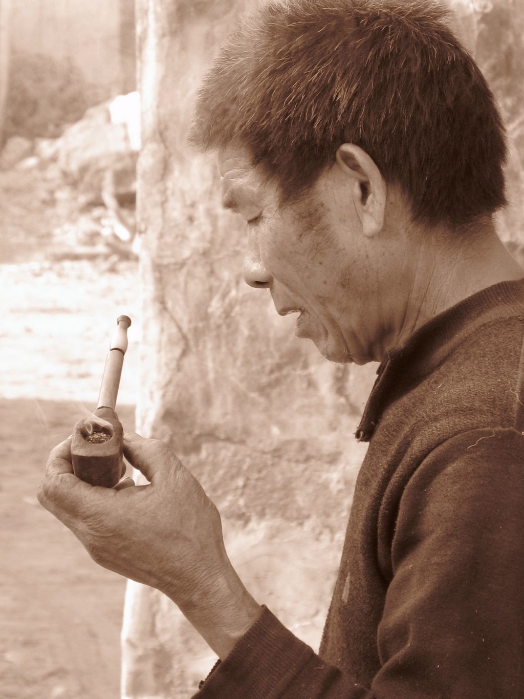 A male villager smoking with a pipe